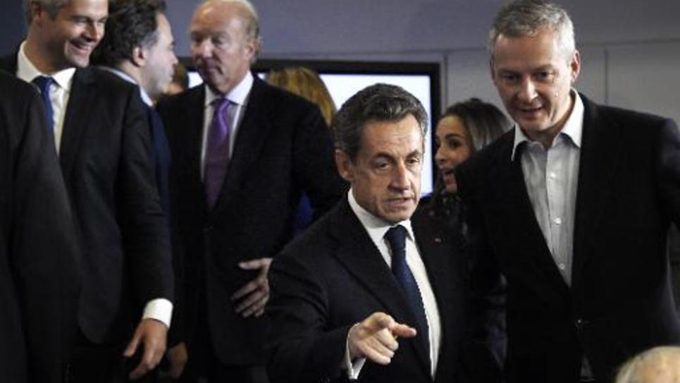 Nicolas Sarkozy et Bruno Lemaire le 13 décembre 2014 à Paris lors d'une réunion des cadres UMP