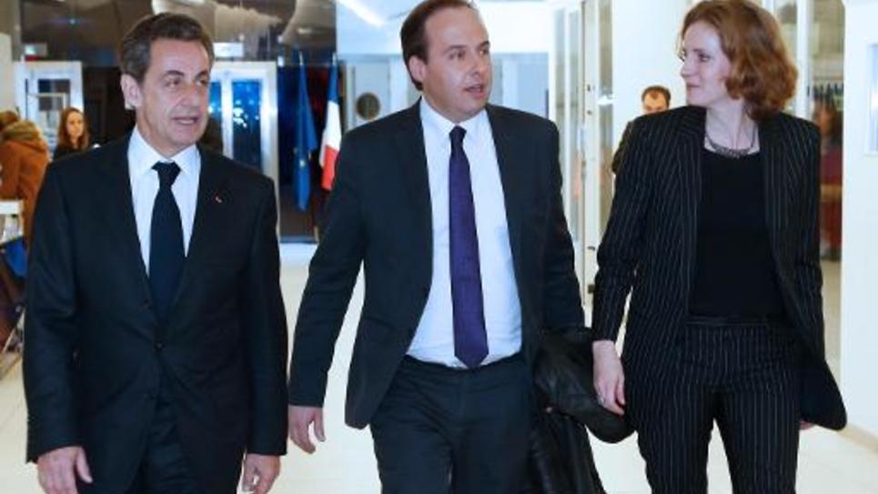 Jean-Christophe Lagarde entre Nicolas Sarkozy et Nathalie Kosciusko-Morizet à l'issue d'une rencontre au siège de l'UMP le 18 décembre 2014 à Paris