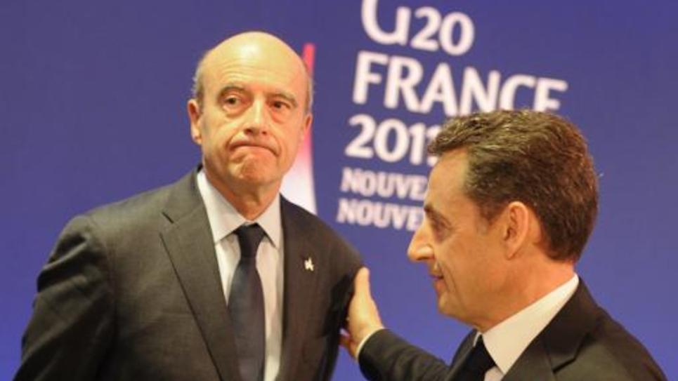 L'ancien président français Nicolas Sarkozy et son ex ministre des Affaires étrangères Alain Juppé, le 3 novembre 2011, lors d'un Sommet à Cannes