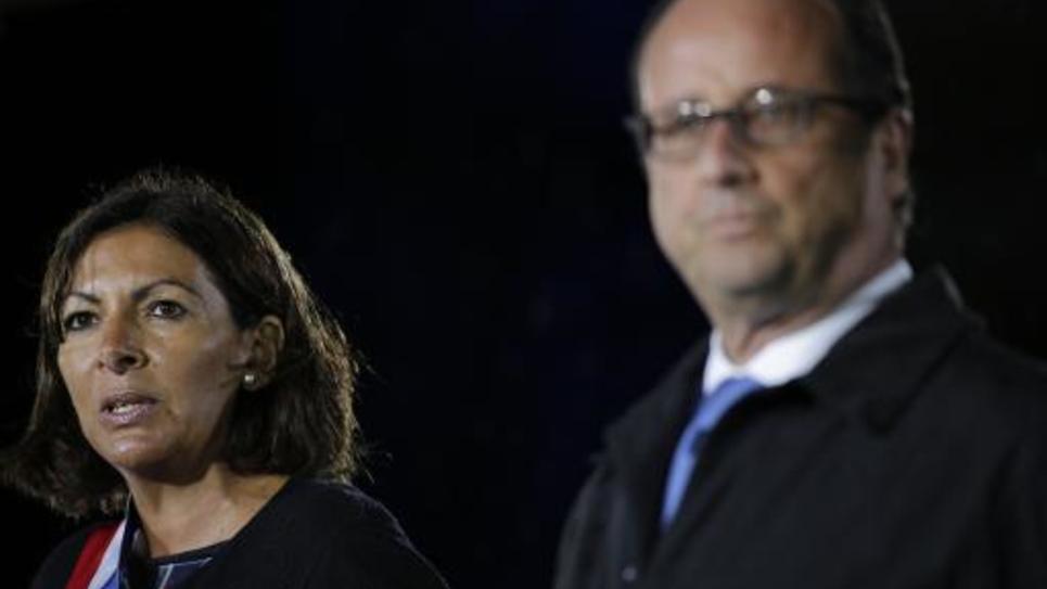La maire de Paris Anne Hidalgo et le président de la République François Hollande à l'Hôtel de Ville de Paris lors d'une cérémonie le 25 août 2014