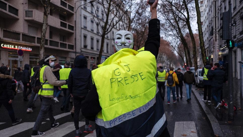 Des Gilets jaunes lors d'une manifestation à Lyon le 22 décembre 2018