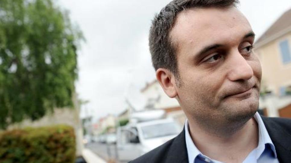 Florian Philippot, vice-président du FN, arrive au siège du parti à Nanterre, le 26 mai 2014