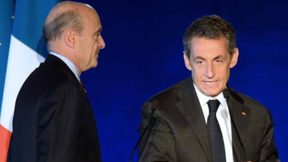 Alain Juppé (g) et Nicolas Sarkozy à Bordeaux, le 22 novembre 2014