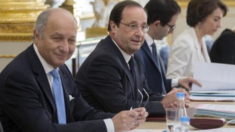 Laurent Fabius et Francois Hollande lors du Conseil des ministres le 18 juin 2014 à l'Elysée à Paris