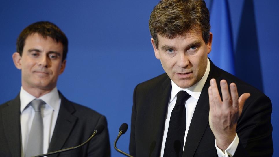 Arnaud Montebourg (D) et Manuel Valls (G) lors d'une conférence de presse conjointe, le 14 mai 2014 à Faverges
