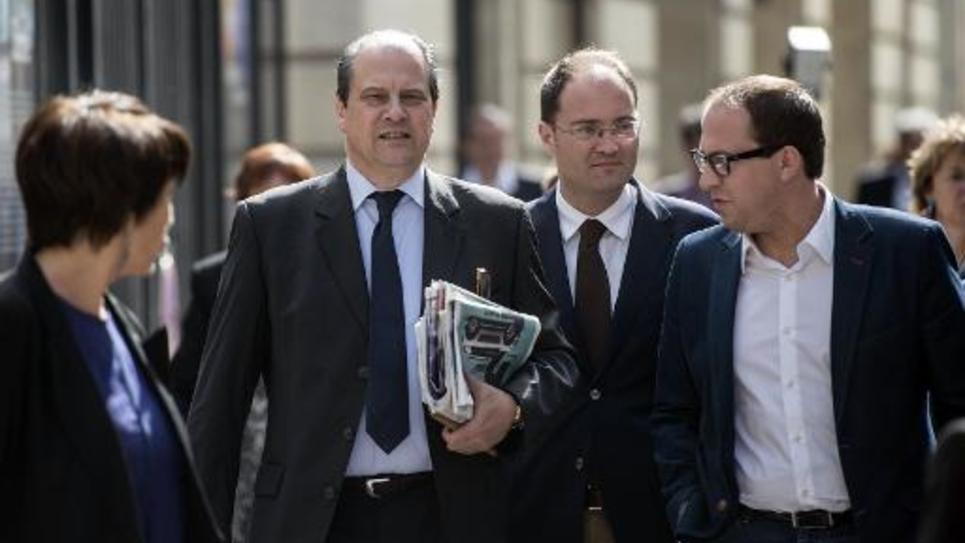 Le premier secrétaire du PS, Jean-Christophe Cambadélis (g), arrive pour le conseil national du PS, à Paris le 14 juin 2014