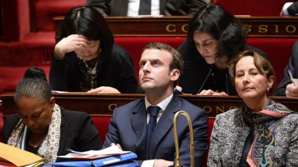 De g à d: les ministres français de la Justice Christiane Taubira, de l'Economie Emmanuel Macron et de l'Ecologie Ségolène Royal à l'Assemblée nationale le 27 janvier 2015 à Paris
