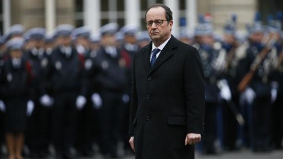 François Hollande lors de l'hommage aux policiers tués à Paris, le 13 janvier 2015 à la Préfecture de police à Paris