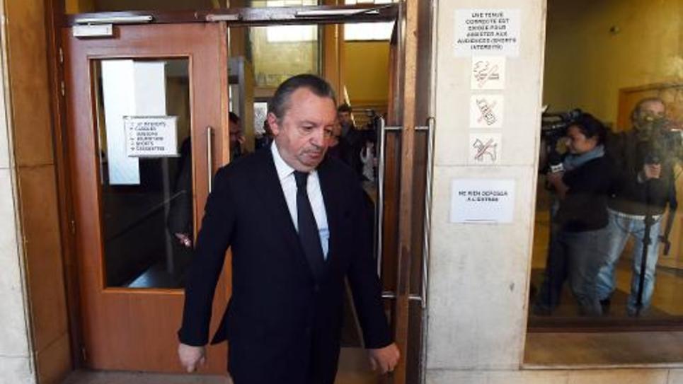 Le président du Conseil général des Bouches-du-Rhôe Jean-Noël Guérini quitte le tribunal de Marseille le 8 décembre 2014