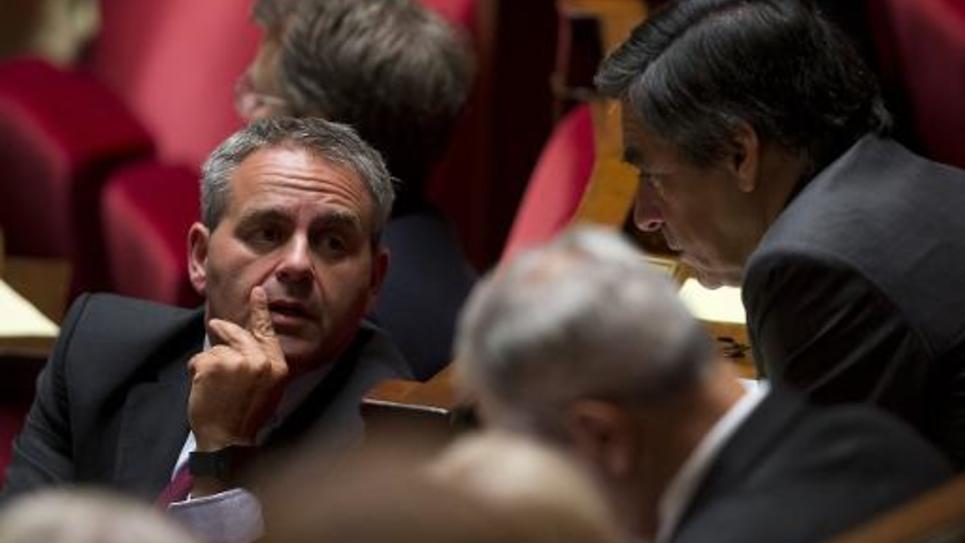 L'ancien ministre UMP Xavier Bertrand (g) à Paris, le 24 septembre 2014