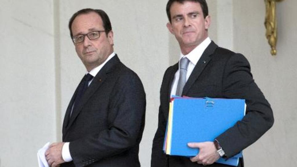 François Hollande et Manuel Valls à la sortie du Conseil des ministres le 22 décembre 2014 à l'Elysée à Paris
