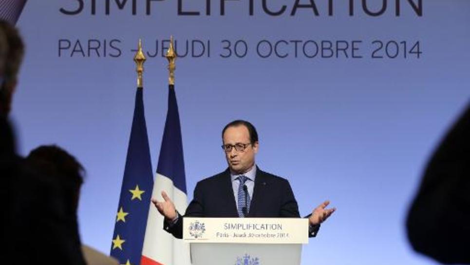 Le président de la République François Hollande clôt le 30 octobre 2014 à Paris le conseil de Simplification