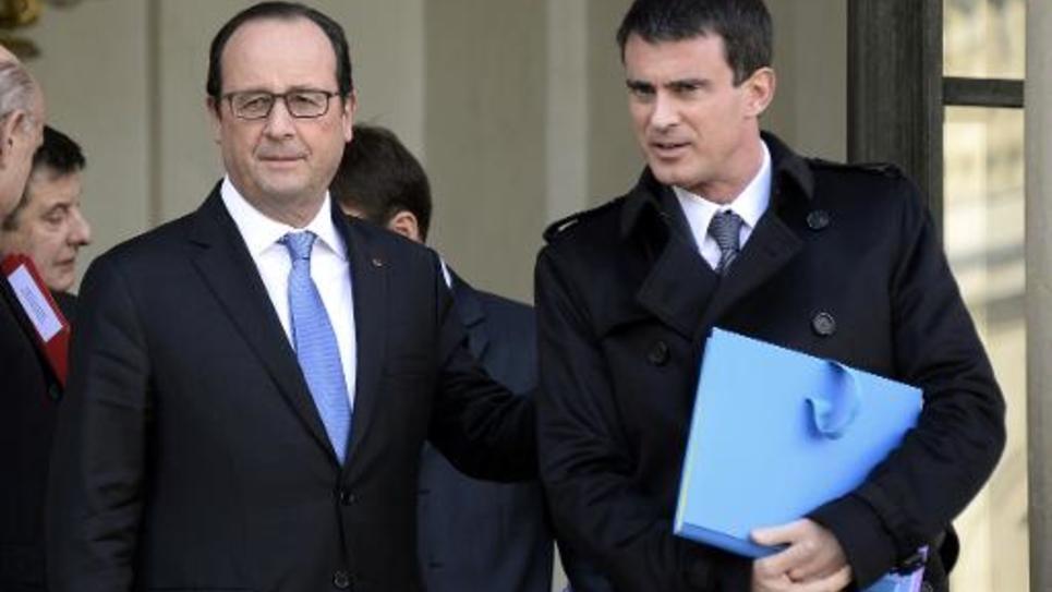 Le président François Hollande et son Premier ministre Manuel Valls, sur le perron de l'Elysée le 29 octobre 2014 après le conseil des ministres