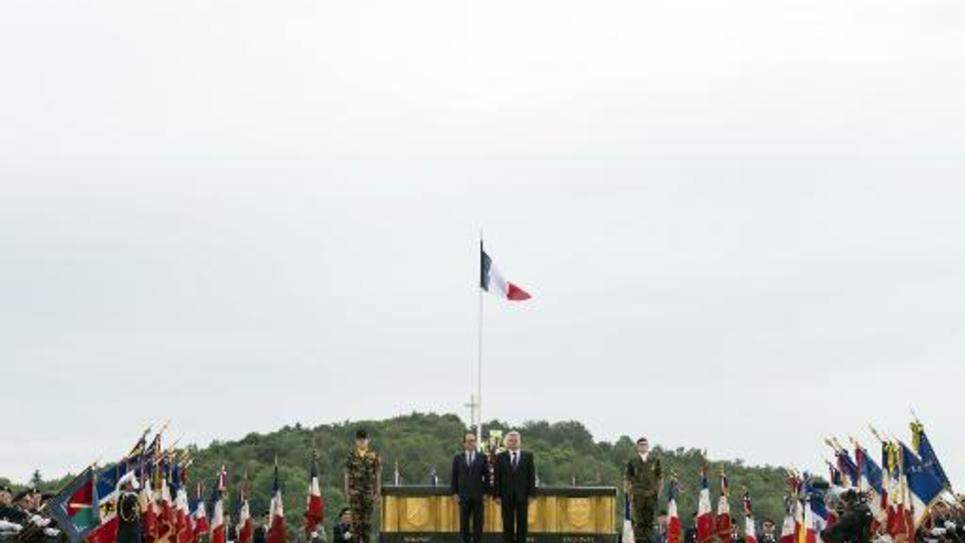 Le président français François Hollande et son homologue allemand Joachim Gauck commémorent le 100e anniversaire de la Première guerre mondiale au monument du Hartmannswillerkopf, à Wattwiller, le 3 août 2014