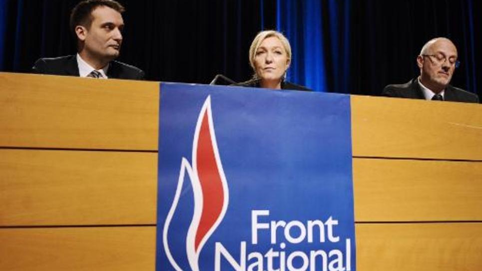 Les leaders du Front National: (de g à d) Florian Philippot, vice-président du FN, Marine Le Pen et Thierry Gourlot, responsable du FN pour la Moselle, le 9 mars 2015 à Metz