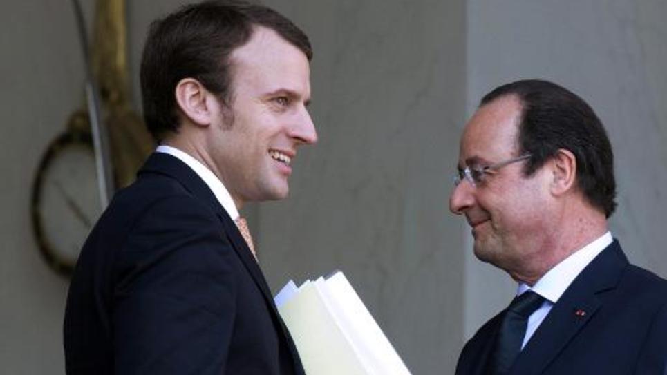 Emmanuel Macron, nommé ministre de l'Economie le 26 août 2014, à l'Elysée en compagnie de François Hollande le 26 mars 2014