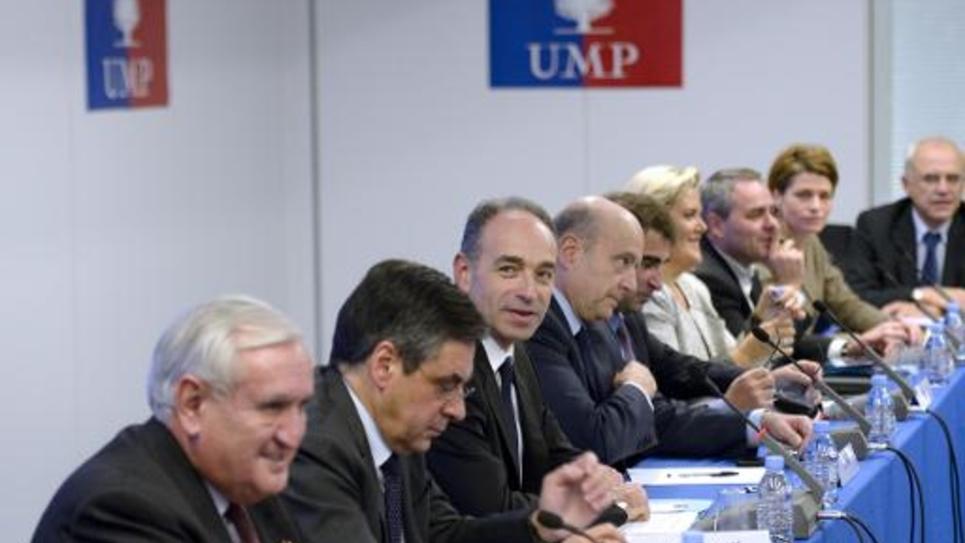 (de g à d) Jean-Pierre Raffarin, François Fillon, Jean-Francois Copé et Alain Juppé le 18 décembre 2013 au siège de l'UMP à Paris