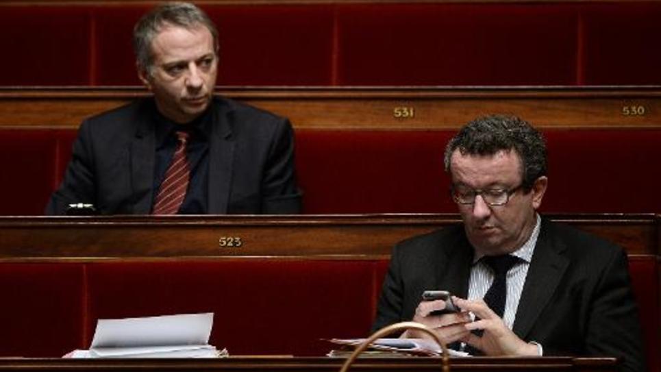 Les députés socialistes Laurent Baumel et Christian Pau le 13 février 2015 à l'Assemblée nationale à Paris