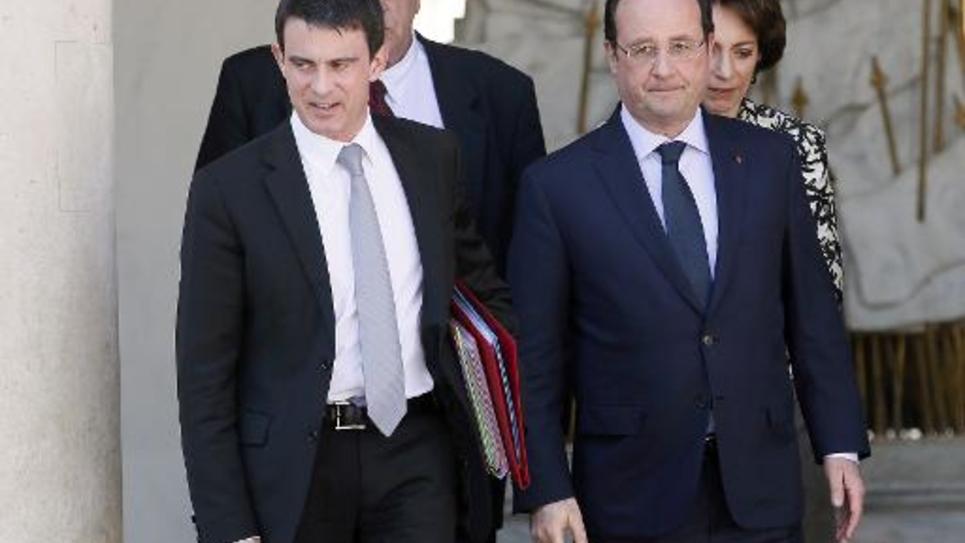 Manuel Valls et François Hollande à la sortie du Conseil des ministres le 16 avril 2014 à l'Elysée à Paris