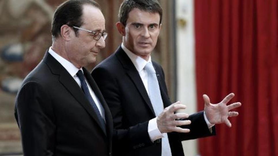 François Hollande (g) et Manuel Valls, le 5 février 2015 à l'Elysée à Paris
