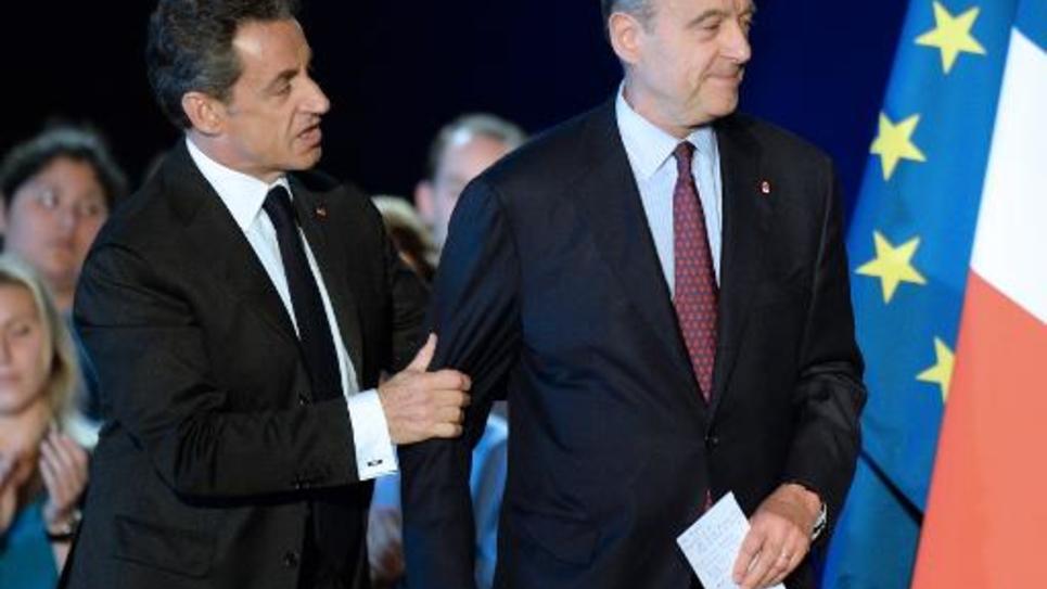 Nicolas Sarkozy et Alain Juppé lors d'un meeting le 22 novembre 2014 à Bordeaux