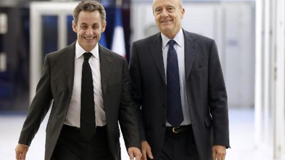 Nicolas Sarkozy au côté d'Alain Juppé le 3 décembre 2014 au siège de l'UMP à Paris