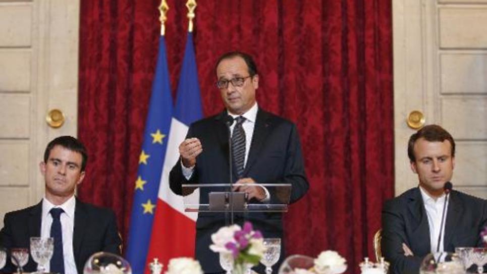 Le président François Hollande s'exprime le 19 octobre 2014 devant unparterre de patrons de grandes entreprises étrangères réunis à l'Elysée