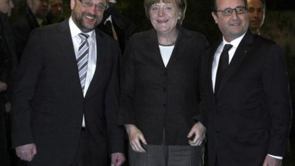 Le président du Parlement européen Martin Schulz, la chancelière allemande Angela Merkel et François Hollande à Strasbourg le 30 janvier 2015
