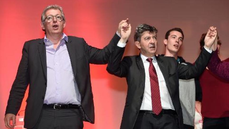 Jean-Luc Mélenchon (à d) co-président du Parti de gauche et Pierre Laurent (à g), secrétaire du Parti communiste le 20 mai 2014 à Toulouse lors d'un meeting