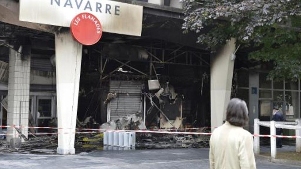 Devanture d'un commerce incendié à Sarcelles, le 21 juillet 2014 au lendemain des affrontements qui ont eu lieu dans cette ville entre pro-palestiniens et forces de l'ordre