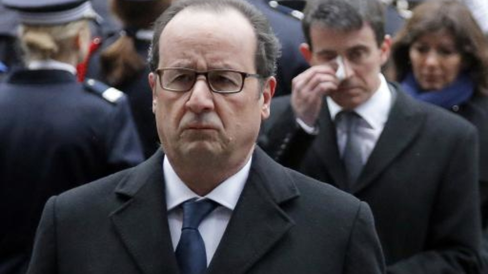 François Hollande et Manuel Valls, lors de l'hommage aux policiers tués, le 13 janvier 2015 à la préfecture de police de Paris