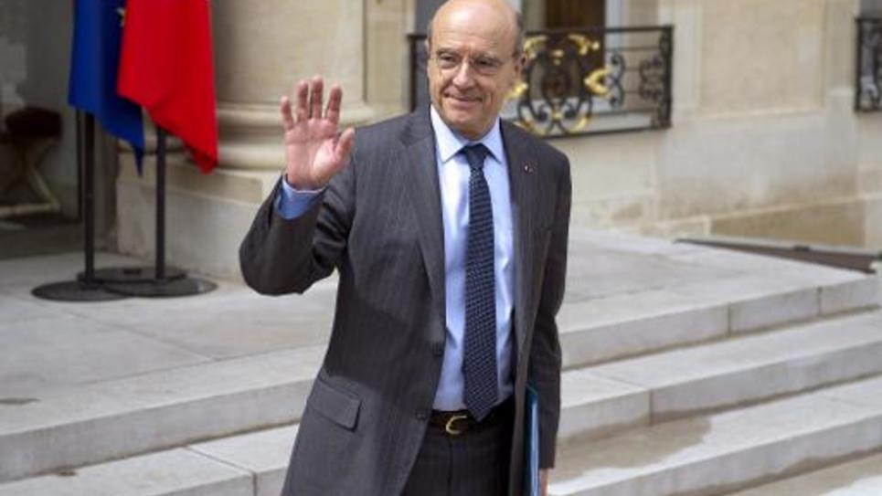 Alain Juppé sur le perron de l'Elyée le 9 mai 2014 à Paris