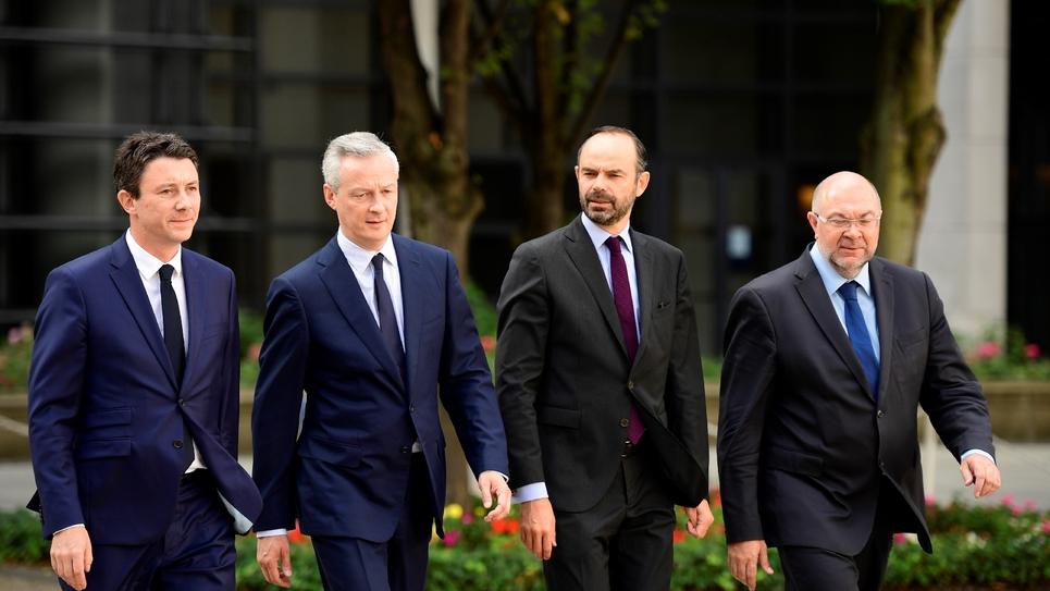 Le secrétaire d'Etat au ministère de l'Economie, Benjamin Griveaux, le ministre de l'Economie Bruno Le Maire, le Premier ministre Edouard Philippe et le ministre de l'Agriculture Stéphane Travert, à Paris le 20 juillet 2017