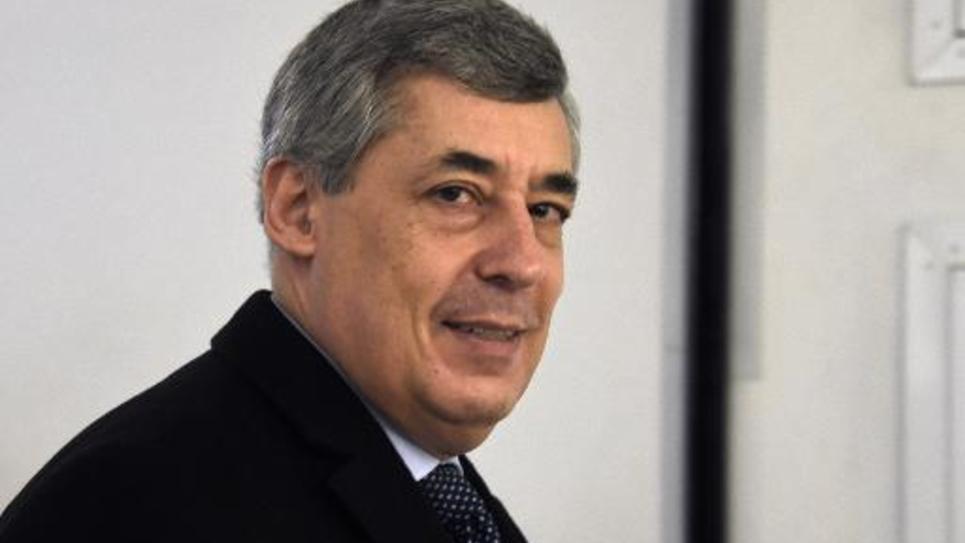 Le député Henri Guaino arrive au siège de l'UMP le 13 décembre 2014 à Paris
