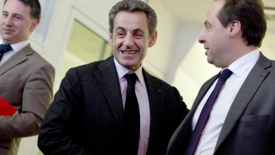 Les présidents de l'UMP et de l'UDI, Nicolas Sarkozy et Jean-Christophe Lagarde, se retrouvent devant la presse après leur entretien post-électoral au siège de l'UMP, le 30 mars 2015 à Paris