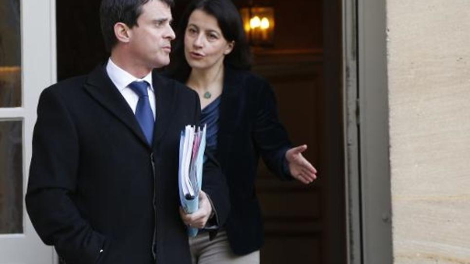 Manuel Valls et Cécile Duflot à l'issue d'une réunion à Matignon  le 20 février 2013 à Paris