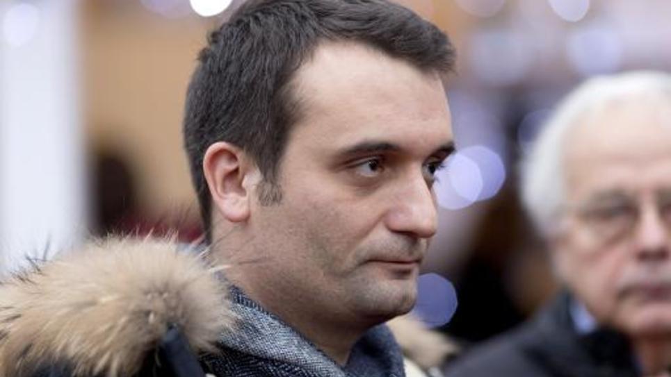 Florian Philippot le 22 décembre 2014 au marché de Noël sur les Champs Elysées à Paris