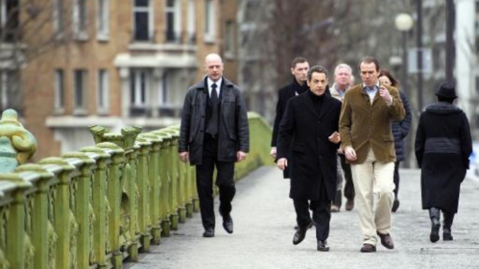 Nicolas Sarkozy et son directeur de campagne Guillaume Lambert le 18 février 2012 à Paris
