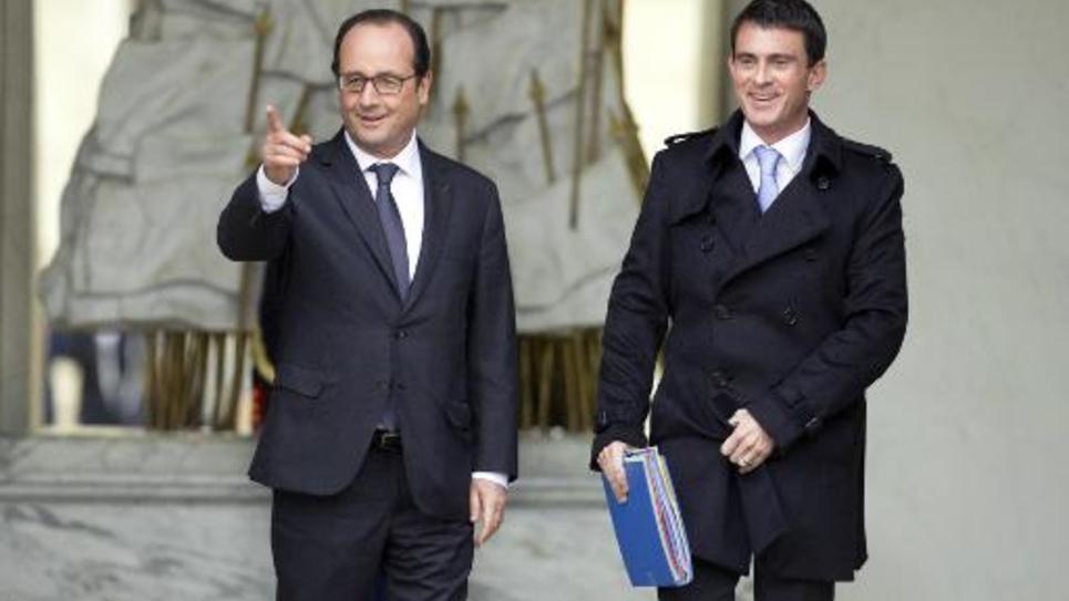 François Hollande et Manuel Valls à l'issue du Conseil des ministres le 26 novembre 2014 à l'Elysée à Paris