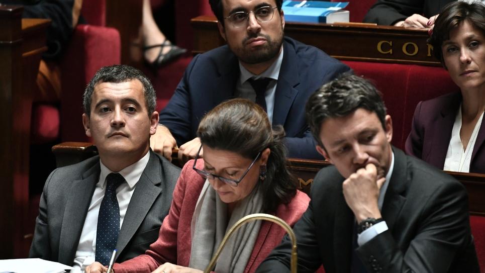 Agnès Buzyn (c) et Gérald Darmanin (g) à l'Assemblée nationale, le 16 octobre 2018