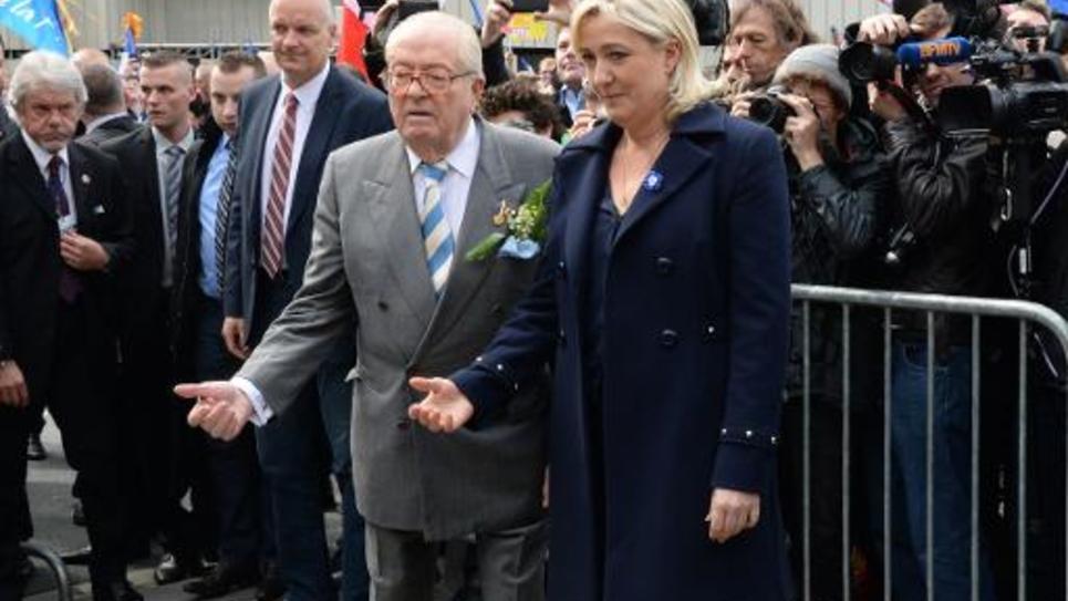 Jean-Marie Le Pen et sa fille Marine Le Pen le 1er mai 2014 à Paris