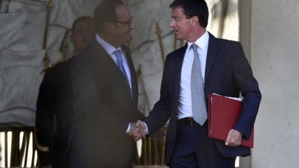 Le président de la République, François Hollande, et le Premier ministre, Manuel Valls, se saluent le 26 août 2014 à l'Elysée à l'issue d'une rencontre sur la formation du nouveau gouvernement