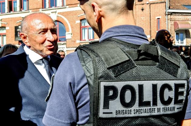 Gérard Collomb avec un policier de la BST à Lille, le 26 septembre 2018