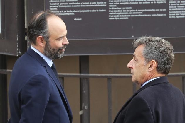 Edouard Philippe (gauche) et Nicolas Sarkozy lors d'une cérémonie en hommage aux victirmes du terrorisme à Paris, le 11 mars 2020