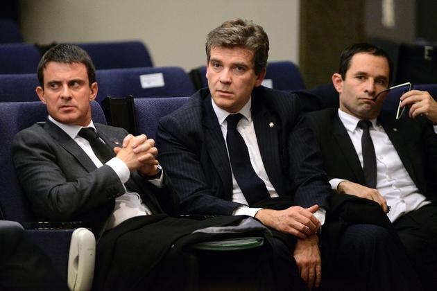 (G à D): Manuel Valls, Arnaud Montebourg et Benoît Hamon, lors d'une conférence de presse le 27 novembre 2013 à Madrid, au cours d'un sommet franco-espagnol
